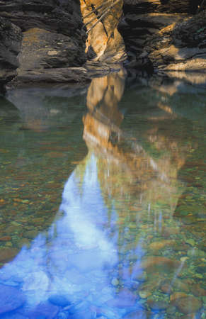 carson ganci: Shallow mountain river with rocky bed