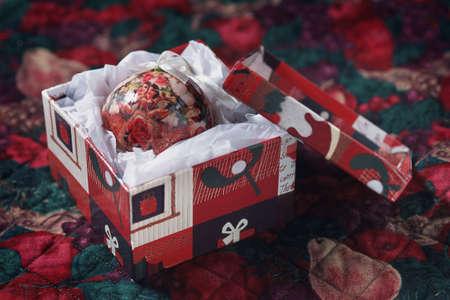 corey hochachka: Decorative Christmas ball in gift box Stock Photo