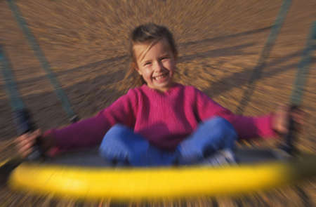 don hammond: Young girl on playground ride