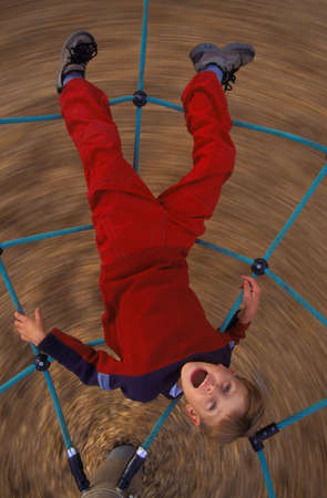 Young girl on playground ride
