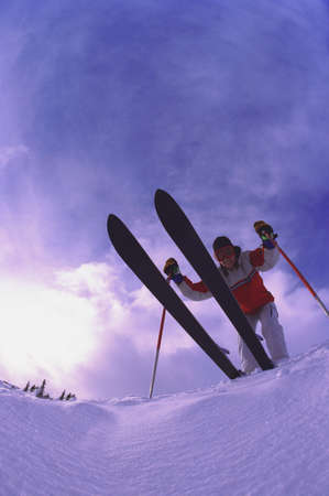 carson ganci: Skier on edge of slope viewed from underneath Stock Photo