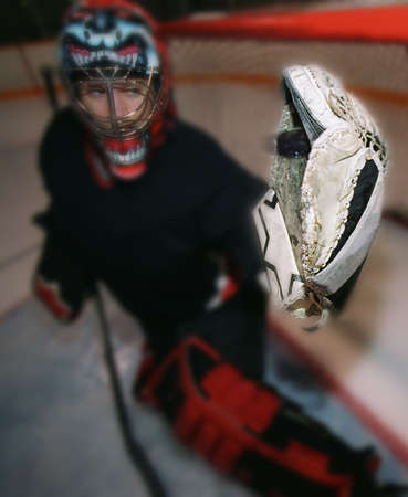 darren greenwood: Young goalie in net with glove extended
