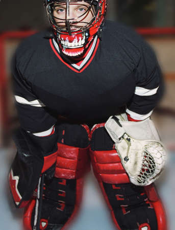 Young hockey goalie in net Stock Photo - 6212981