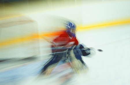 Ice hockey goalie making save Stock Photo