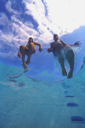 treading: Underwater image of two swimmers in ocean Stock Photo