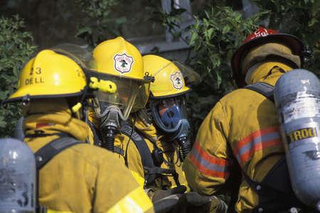 corey hochachka: Firemen with masks outside building