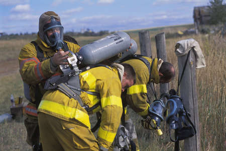 corey hochachka: Fireman adjusting equipment on partner