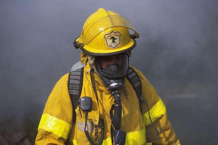 fireman: Fireman in front of smoke Stock Photo