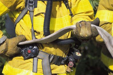 Fireman holding empty hose