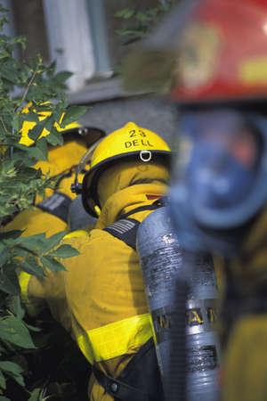 corey hochachka: Firemen walking to building Stock Photo