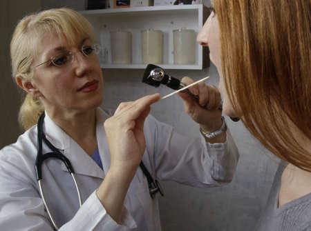 examine: Doctor examining patient