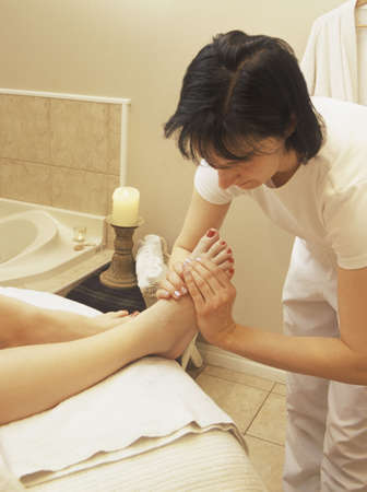 Woman getting foot massage Imagens