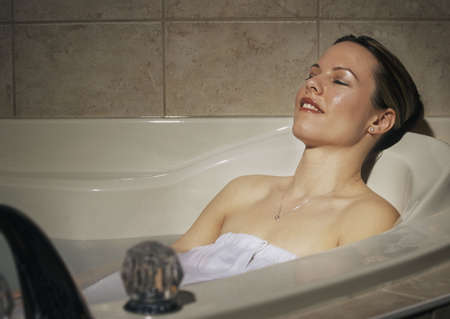 Woman relaxing in hot tub Stock Photo