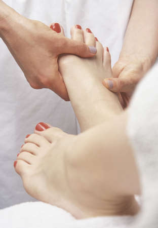 Woman getting foot massage photo