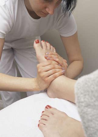 darren greenwood: Woman getting foot massage Stock Photo