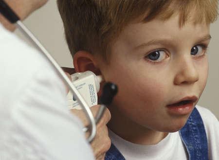darren greenwood: Boy getting ear examined by doctor