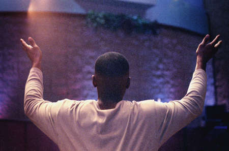 with raised: Man with hands raised in worship