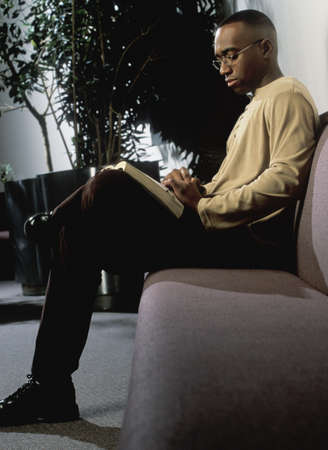 study: Man reading on couch