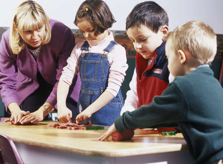 Children playing with supervisor