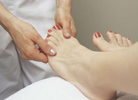 Woman receiving a foot massage photo