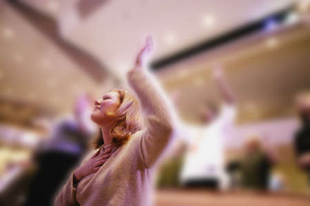 serene people: Woman worshipping in church Stock Photo