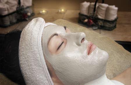 얼굴 표정: Woman getting a facial 스톡 사진