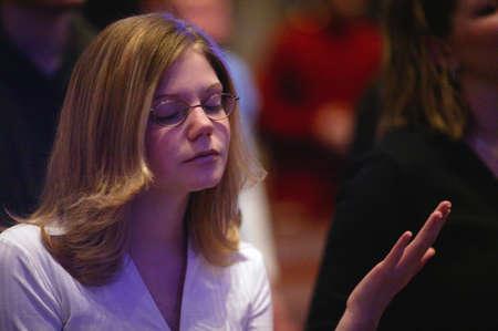 don hammond: Woman raising hand in worship Stock Photo