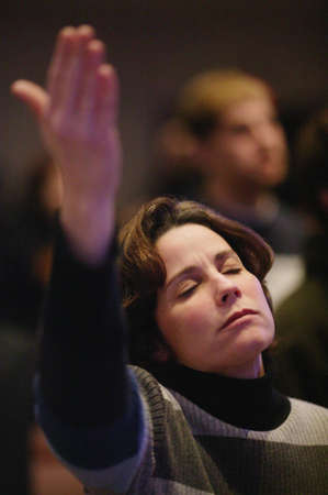 glorify: Woman raising hand in worship Stock Photo