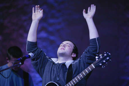 Man raising hands in worship photo