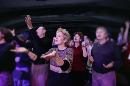 praise and worship: Adult worship service Stock Photo