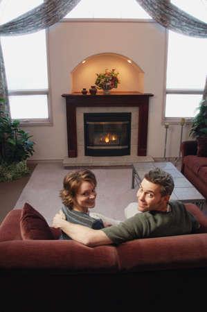 darren greenwood: Couple relaxing in front of fire
