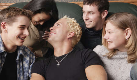 Group of young people laughing together