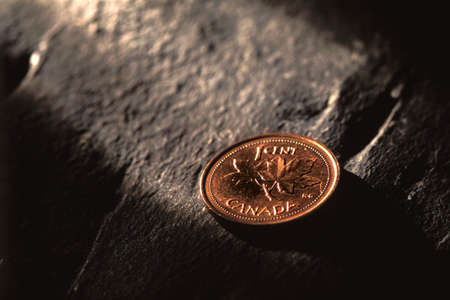 canadian cash: Sun shining penny Stock Photo
