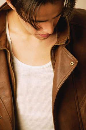 pierced ears: Brown leather jacket Stock Photo