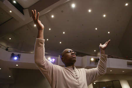 reverence: Man worshipping in church Stock Photo