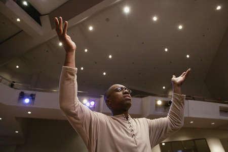 church worship: Man worshipping in church Stock Photo