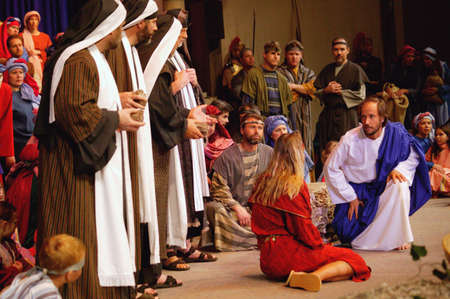 humility: Jesus speaks with adultress Stock Photo