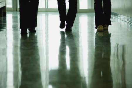 Students walk down hallway Stock Photo