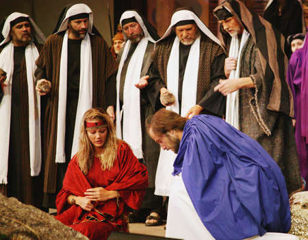 prostitute: Jesus draws in the sand Stock Photo