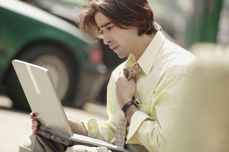 Man working on lap top computer