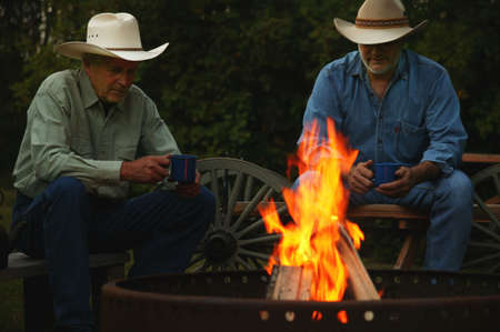 bonfire night: Two men sitting by a fire