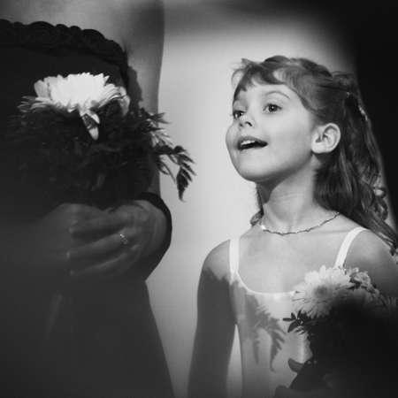 Flowergirl peeks at the bride