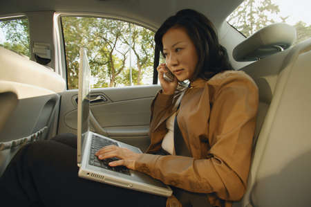 carson ganci: Businesswoman on the cell phone Stock Photo