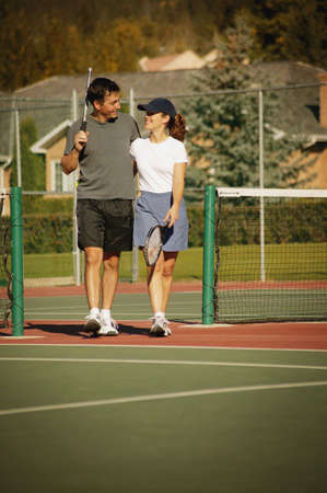 Couple in tennis courts Stock Photo - 6213603