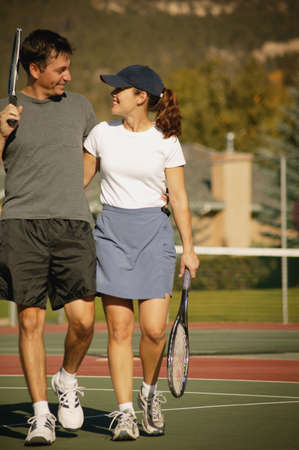 Couple in tennis courts Stock Photo - 6213604