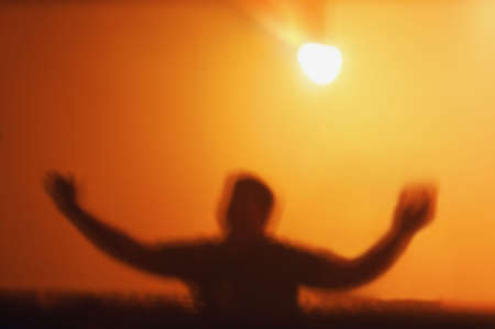 glubish: A person under bright light Stock Photo