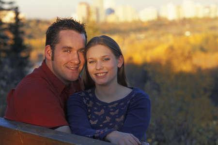 corey hochachka: Couple on a park bench Stock Photo