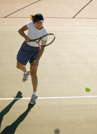 Woman plays tennis photo