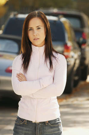 fixate: Woman stands on the sidewalk Stock Photo