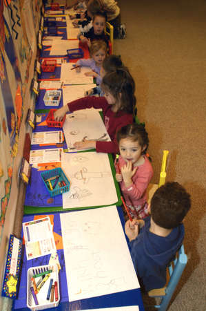 carson ganci: Preschool age children drawing pictures in their kindergarten class Stock Photo